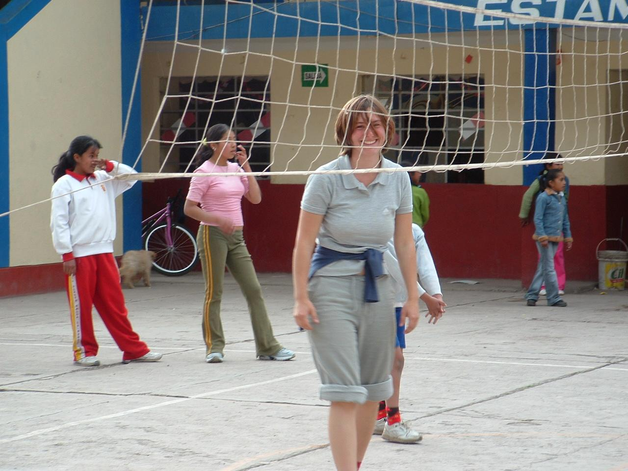 A volleyball instructor volunteers as a sports coach in schools in Peru